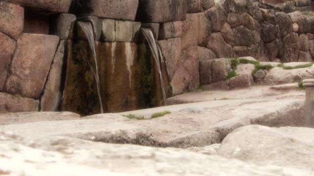 inca fountain ruin at tambomachay, cusco, peru - fortress stock videos & royalty-free footage