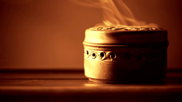 incense burner on table. - incense stock videos & royalty-free footage