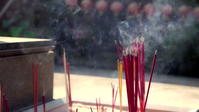 incense chinese traditional with rim light in thailand. - incense stock videos & royalty-free footage