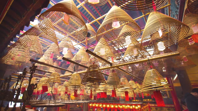 incense coils burning at man mo temple, hong kong - literature stock videos and b-roll footage