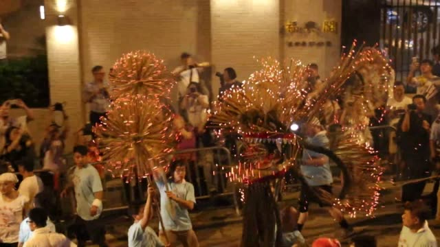 Incense inserted dragon dancing in streets in Hong Kong's Tai Hang area A tradition of 100 old