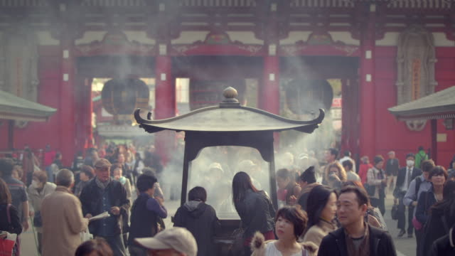 incense smoke at sensoji temple, tokyo japan. - pagoda stock videos & royalty-free footage