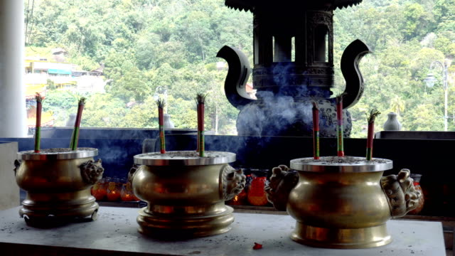 incense smoking in the buddhist temple - penang stock videos and b-roll footage
