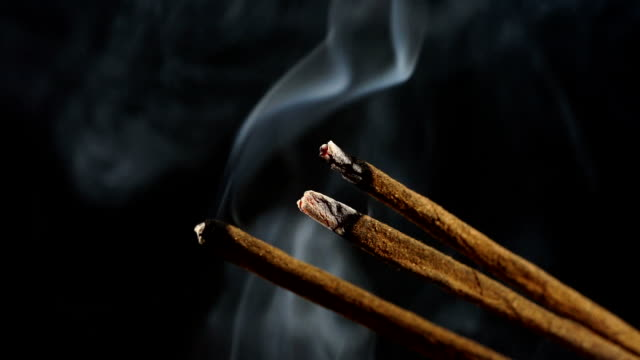 incense stick on black - incense stock videos & royalty-free footage