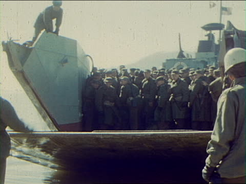 stockvideo's en b-roll-footage met inchon harbor new replacement troops come ashore from landing barges / south korea - incheon