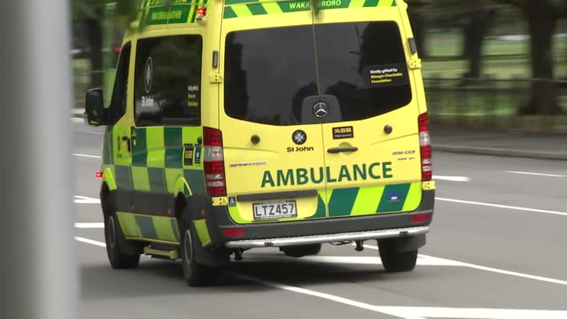 including ambulance vehicles with lights flashing and sirens sounding driving on streets surrounding christchurch hospital in central christchurch... - christchurch stock-videos und b-roll-filmmaterial