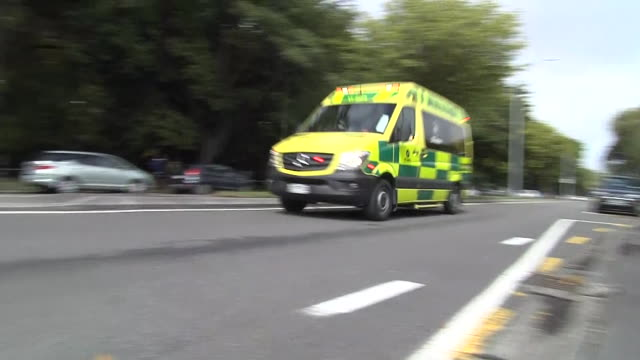 including ambulance vehicles with lights flashing and sirens sounding driving on streets nearby masjid al noor mosque in wake of mass shootings - christchurch stock-videos und b-roll-filmmaterial