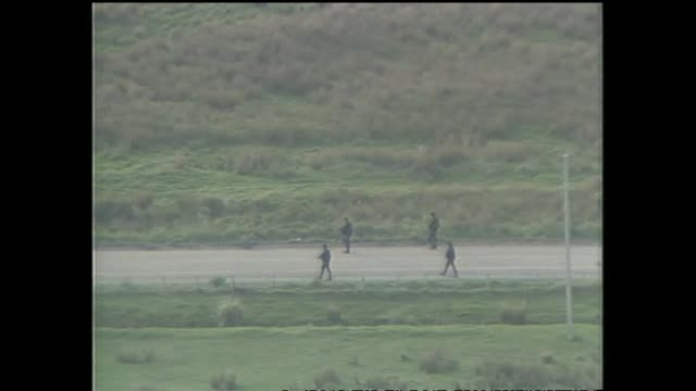 including armed police approaching aramoana settlement in operation to apprehend perpetrator david gray - murder stock videos & royalty-free footage