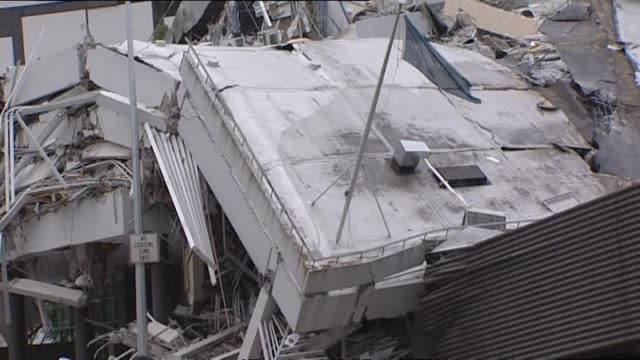 including collapsed roof and mangled steel framing. - christchurch stock-videos und b-roll-filmmaterial