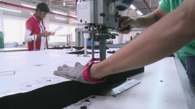 Including ironing folding and packing of goods such as trousers for export This is a wellrun ISO standard facory but in many ittle has changed since...