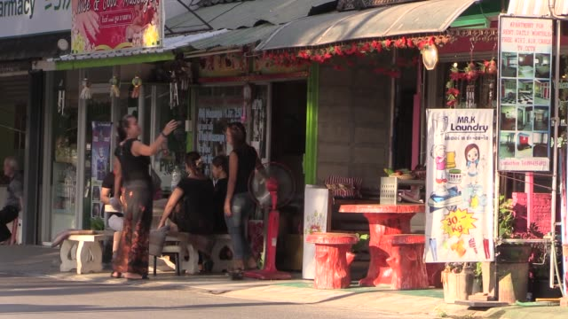 including massage parlours, laundry and bars. in chiang mai, northern thailand. - 堀点の映像素材/bロール