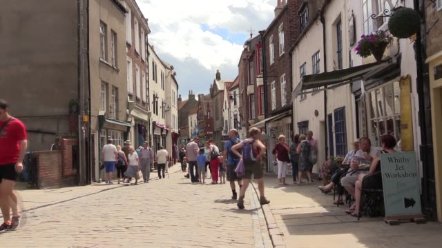 including people window shopping and exploring the small cobbled streets whitby is the town where in the novel dracula arrived in great britain - whitby north yorkshire england stock videos & royalty-free footage