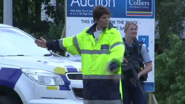including police vehicles with lights flashing and sirens sounding driving around streets of central christchurch armed police officer overseeing... - murder stock videos & royalty-free footage