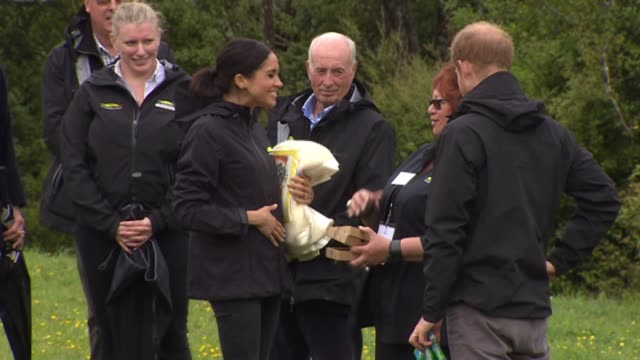 including royal couple hold gifts of woollen baby blanket children's storybook and gumboots duchess meghan touches hand to pregnant stomach prince... - stivale video stock e b–roll