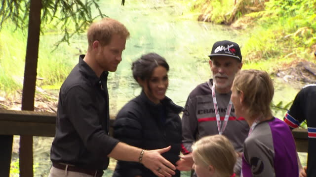 including royal couple overlook scenic freshwater pool meet local mountain bikers and receive tuatara soft toy gift at redwood forest in whakarewarewa - harry meghan tour stock videos and b-roll footage