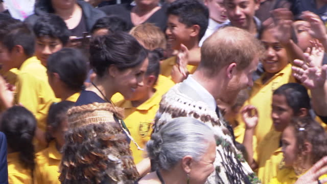 including royal couple shake hands and chat with school children and hongi with local man and maori chefs, outside st faith's anglican church in... - anglican stock videos & royalty-free footage