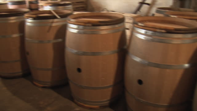 ms pan incomplete butts in winery / bordeaux, gironde, france - wine cask stock videos and b-roll footage