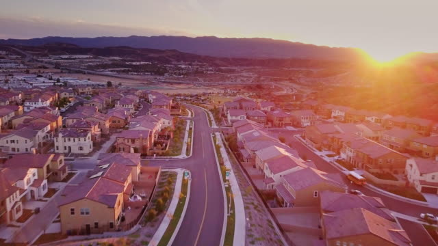 incomplete homes in tract housing development - aerial view - santa clarita video stock e b–roll