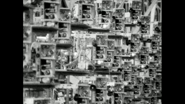 incomplete television sets carried on production line; 1966 - automated stock videos & royalty-free footage