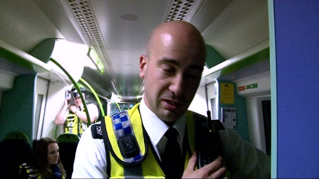 increase in theft of copper cables from london underground; int train transport police in driver's cabin speaking to each other sot pc mike lee... - scientific imaging technique stock videos & royalty-free footage