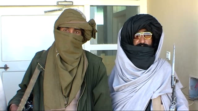 Increase in troop numbers Helmand Province Musa Qala Burhani speaking as stands with fighters armed with rifles Burhani speech SOT On successes of...