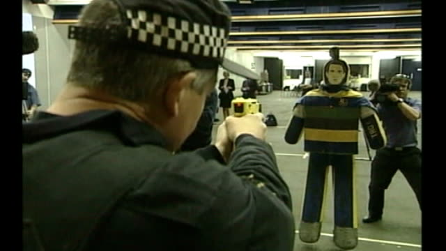 increase in use of tasers by police; tx 17.4.2003 northamptonshire: various shots of police officers carrying out taser stun gun training - northamptonshire stock-videos und b-roll-filmmaterial