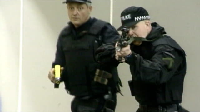 Increase in use of tasers by police TX Various shots of police officers carrying out taser stun gun training