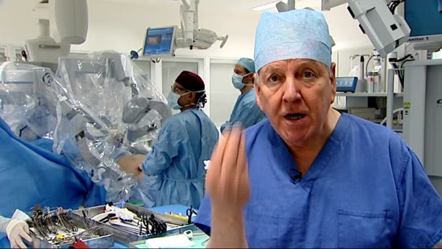 increase of operations performed with robotic help england london paddington st mary's hospital int various shots surgeons and other medical staff... - robotic surgery stock videos and b-roll footage