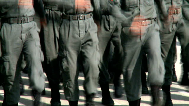 vídeos y material grabado en eventos de stock de increased numbers of women police officers; afghanistan: kabul: ext various of afghan police recruits marching - military recruit
