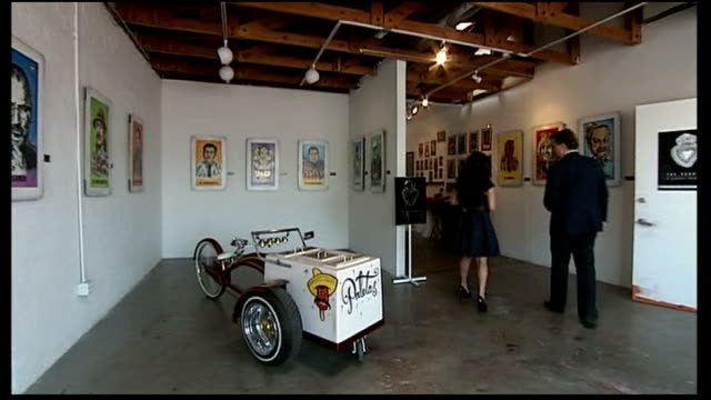 increasing numbers of immigrants being deported reporter to camera deedee garcia blase setup talking with reporter in art gallery and interview sot... - 見渡す点の映像素材/bロール