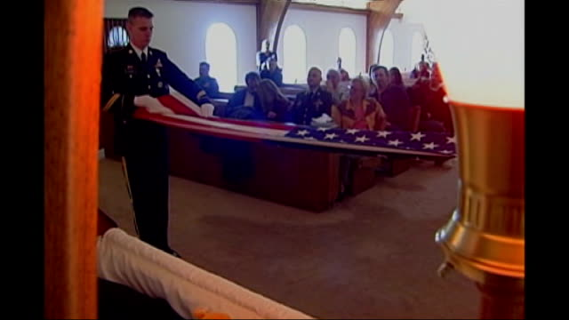 increasing numbers of suicides among us service personnel in iraq; california: tracy: michael crutchfield's corpse laid out in coffin as soldiers... - folded stock videos & royalty-free footage