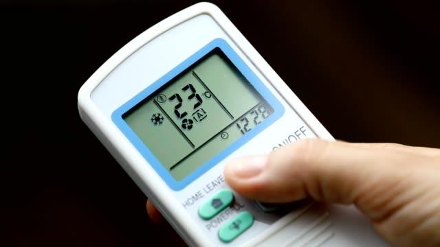 increasing temperature via remote control - eco life - remote control stock videos & royalty-free footage