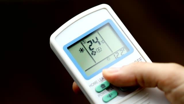 increasing temperature via remote control - eco life - heat stock videos & royalty-free footage
