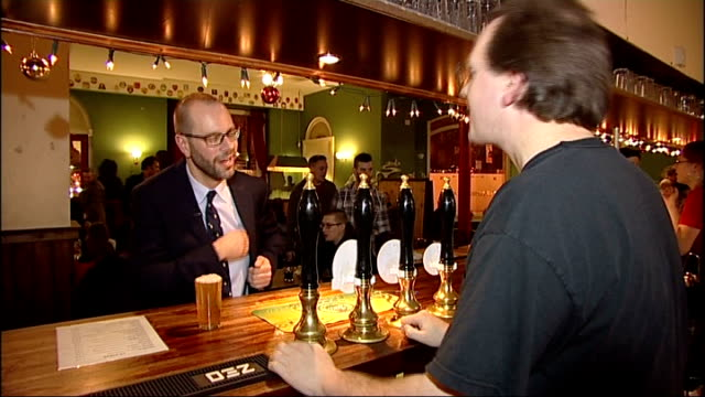 increasing use of bitcoin / consumers warned of dangers england london pembury tavern int various of people being served drinks in the pembury tavern... - bitcoin stock videos & royalty-free footage