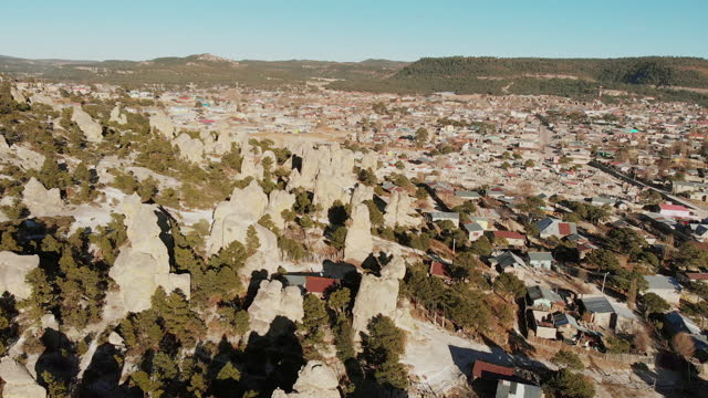 incredible drone video of caldera formations around the little town of san juanito, chihuahua, sierra madre, copper canyon, mexico - chihuahua stock videos & royalty-free footage
