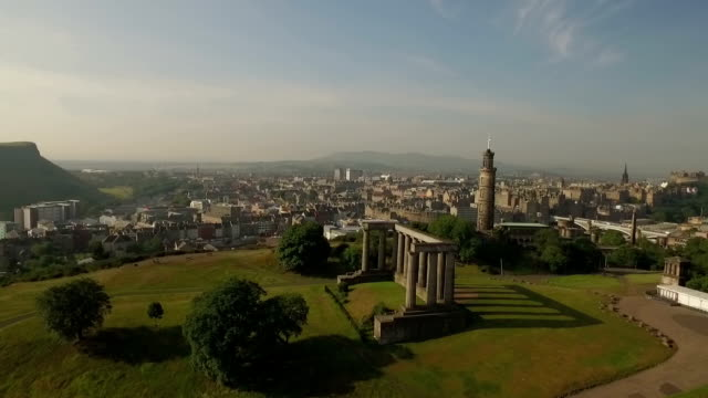 incredible shot of calton hill, revealing the skyline of edinburgh, scotland - edinburgh scotland stock videos & royalty-free footage