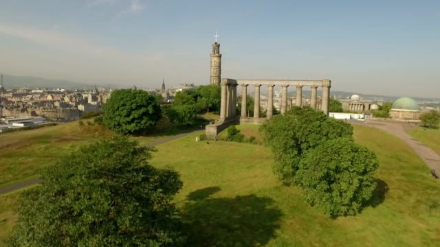 incredible shot of calton hill, revealing the skyline of edinburgh, scotland - calton hill national monument stock videos and b-roll footage