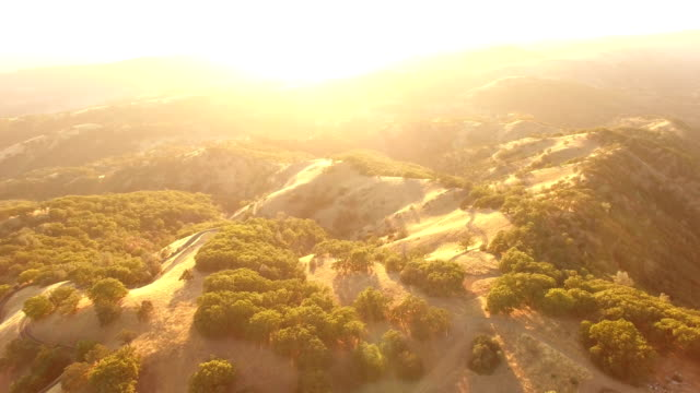 incredible sunlight bursting over horizon over california hills by drone - low lighting stock videos & royalty-free footage