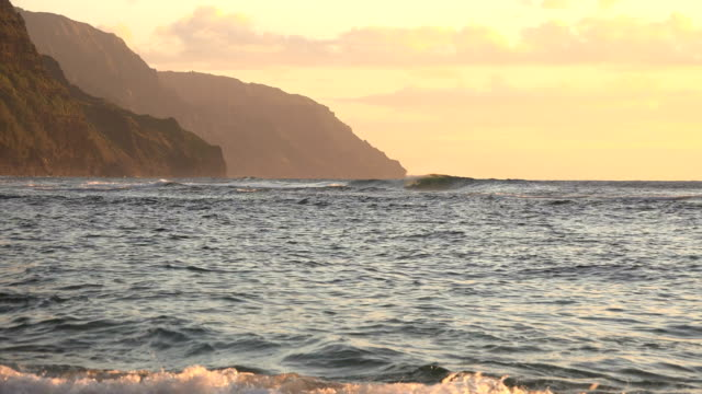 incredible sunset colors over mountains on kauai island - butte rocky outcrop stock videos & royalty-free footage