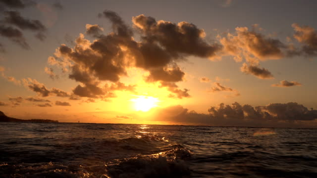 incredibly deep colors from sunset off kauai island - butte rocky outcrop stock videos & royalty-free footage