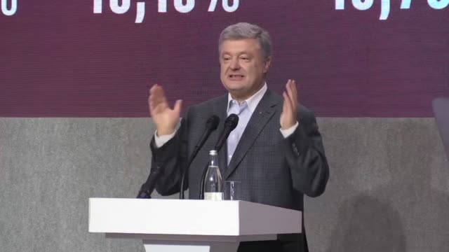 Incumbent Ukrainian President Petro Poroshenko arrives at his headquarters after the announcement of provisional results which put him in second...