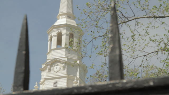 la independence hall bell tower seen through iron fence spikes / philadelphia, pennsylvania, united states - independence hall stock videos and b-roll footage