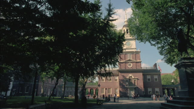 independence hall stands tall in philadelphia. - independence hall stock videos & royalty-free footage