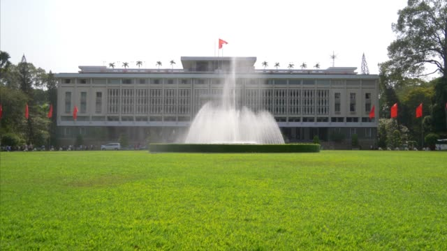 independence palace in saigon aka ho chi minh city, vietnam, lawn and water fountain - palace stock videos & royalty-free footage