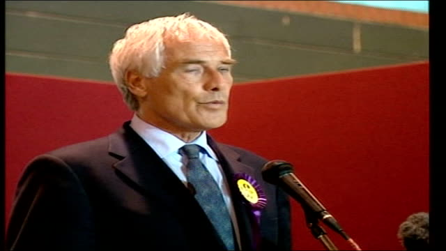 UK Independence Party LIB Northampton EXT Kilroy Silk speaking at microphone People milling around hall at EU election vote count Kilroy Silk putting...