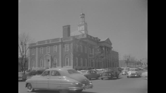 ws independence square area of independence missouri with pedestrians approaching and passing the camera as they walk across street in the foreground... - missouri stock videos and b-roll footage