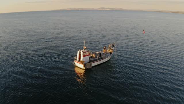 independent fisherman managing trawl net on fishing boat - sea water bird stock videos & royalty-free footage