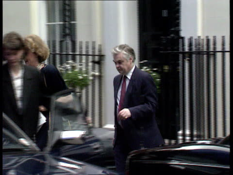 bcci independent inquiry to be held ext downing st ms chancellor of the exchequer norman lamont mp and woman out of no 11 pan around to car - chancellor of the exchequer stock videos and b-roll footage