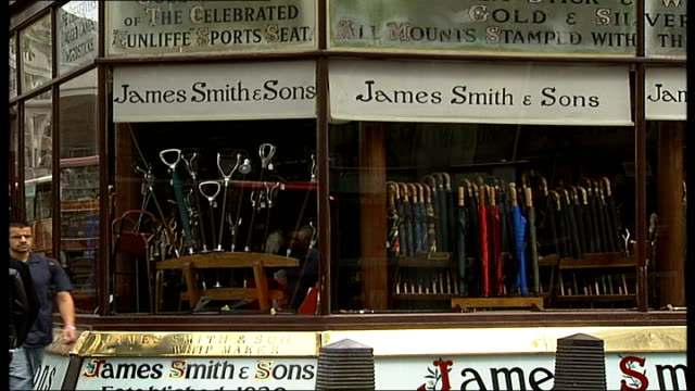 independent shops celebrated in new photographic book woman looking in shop window exterior of 'james smith sons' shop int small wooden mannequins... - independence stock videos & royalty-free footage