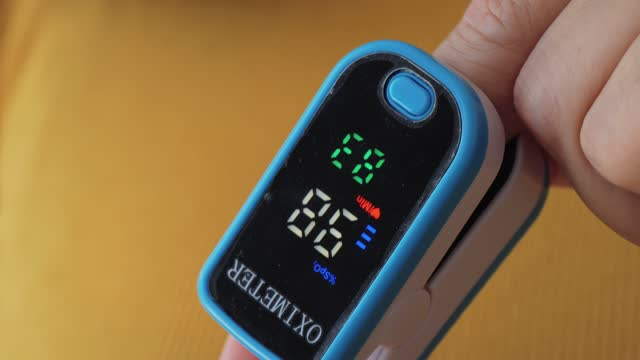 index finger for pulse oximeter with yellow background, healthy lifestyle concept. - index finger stock videos & royalty-free footage